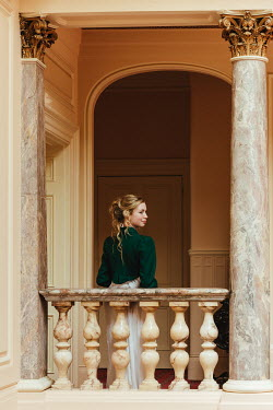 Matilda Delves BLONDE HISTORICAL WOMAN BY MARBLE PILLARS INDOORS