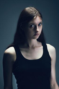 Magdalena Russocka modern woman in shadow inside
