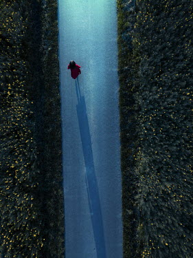Magdalena Russocka woman in red dress walking on country road at night from above