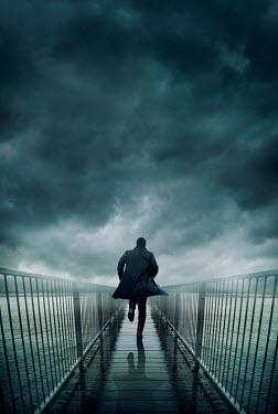 Silas Manhood MAN RUNNNG ON BRIDGE BY STORMY RIVER