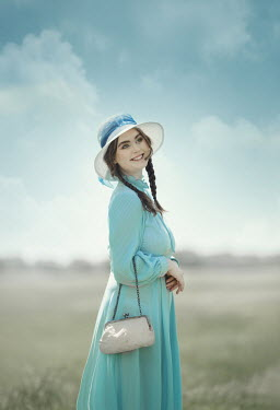 Anna Buczek SMILING RETRO GIRL WITH HAT IN COUNTRYSIDE