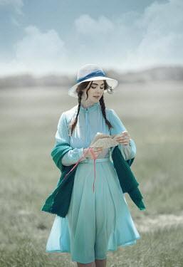 Anna Buczek RETRO GIRL READING LETTER IN COUNTRYSIDE