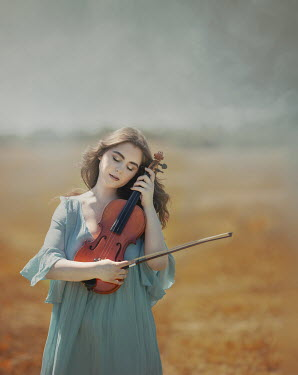 Anna Buczek DAYDREAMING GIRL WITH VIOLIN STANDING IN COUNTRYSIDE