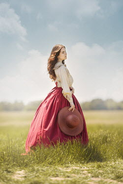 Anna Buczek HISTORICAL WOMAN WITH HAT STANDING IN COUNTRYSIDE