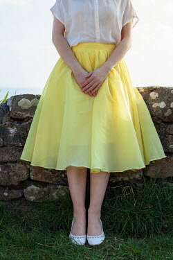 Marie Carr WOMAN IN YELLOW SKIRT BY COASTAL WALL