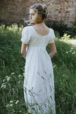 Matilda Delves BLONDE REGENCY WOMAN STANDING IN GARDEN