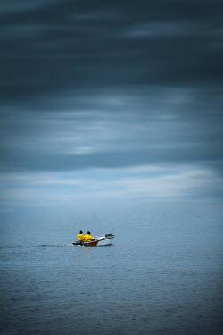 Magdalena Russocka two people on speedboat on lake