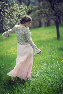 Carmen Spitznagel GIRL IN PINK SKIRT IN FIELD WITH TREES