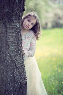 Carmen Spitznagel GIRL IN SILKY SKIRT STANDING BY TREE