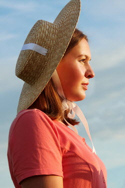Jasenka Arbanas WOMAN WITH STRAW HAT OUTDOORS IN SUMMER