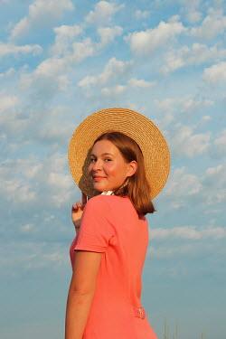 Jasenka Arbanas HAPPY WOMAN WITH STRAW HAT OUTDOORS