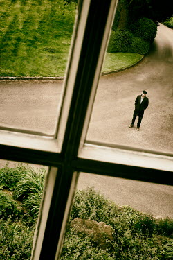 Tim Robinson MAN IN DRIVEWAY STARING AT HOUSE