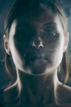 Magdalena Russocka young woman in smoke behind glass