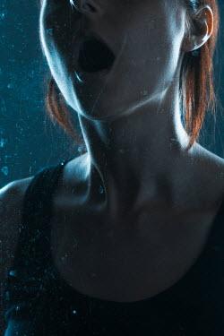 Magdalena Russocka modern young woman screeming behind glass