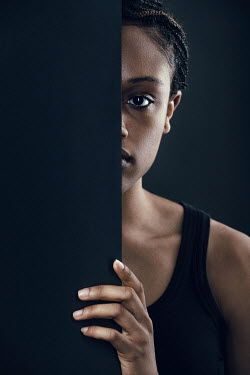 Magdalena Russocka young african woman staring from behind wall