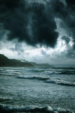 Nic Skerten HOUSE ON CLIFFS WITH STORMY SEA