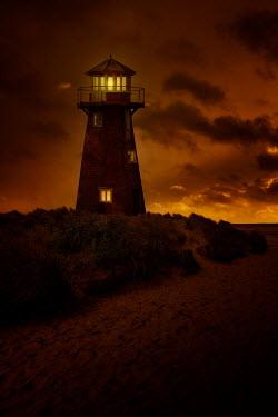 Nic Skerten LIGHTS IN LIGHTHOUSE GLOWING AT SUNSET