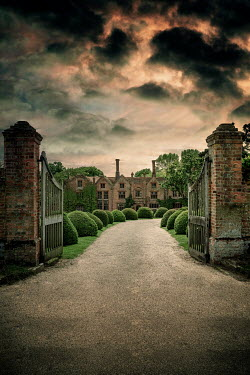 Nic Skerten HISTORICAL MANSION WITH DRIVE AND GATES AT DUSK