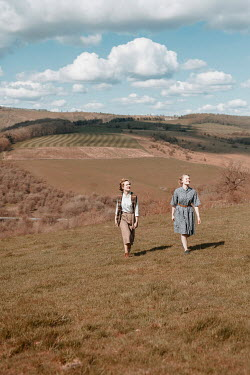 Shelley Richmond TWO RETRO WOMAN WALKING IN AUTUMN LANDSCAPE