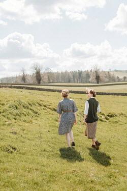 Shelley Richmond TWO RETRO WOMAN WALKING IN COUNTRYSIDE