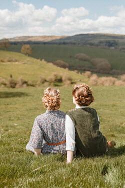 Shelley Richmond TWO RETRO WOMEN SITTING IN COUNTRYSIDE