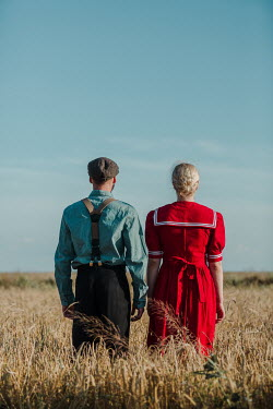 Magdalena Russocka retro couple standing in field