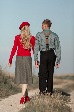 Magdalena Russocka retro couple on dirt road in fields