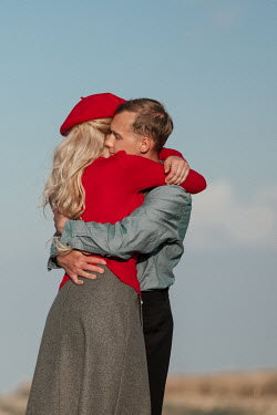 Magdalena Russocka close up of retro couple embracing in field