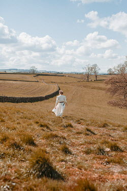 Shelley Richmond RETRO WOMAN WALKING IN AUTUMN LANDSCAPE