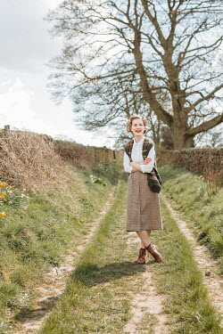 Shelley Richmond HAPPY RETRO WOMAN STANDING IN COUNTRY LANE