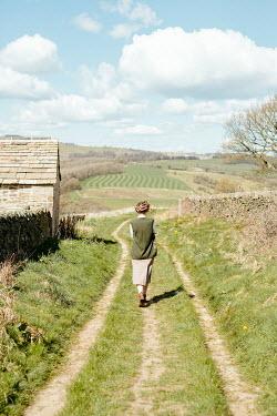 Shelley Richmond RETRO WOMAN WALKING IN COUNTRY LANE
