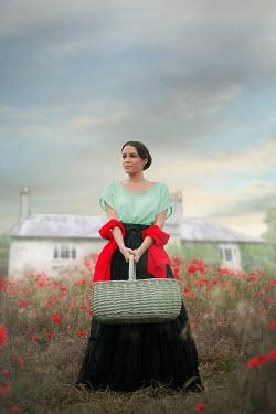 Ildiko Neer Historical woman standing in meadow by house