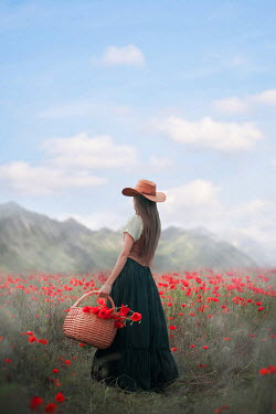 Ildiko Neer Historical woman in cowboy hat standing countryside