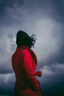 Marie Carr WOMAN IN RED COAT WATCHING STORMY SKY