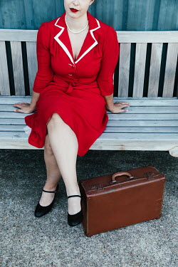 Matilda Delves RETRO WOMAN WITH SUITCASE SITTING ON BENCH