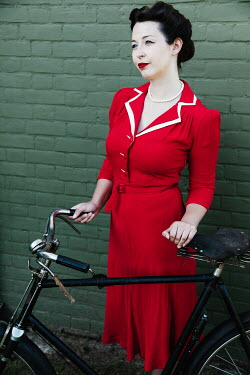 Matilda Delves RETRO WOMAN OUTDOORS WITH BICYCLE