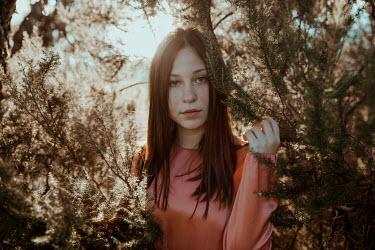 Greta Larosa BRUNETTE TEENAGE GIRL BY TREE OUTDOORS