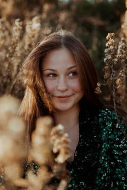 Greta Larosa SMILING YOUNG GIRL IN SUNLIT MEADOW
