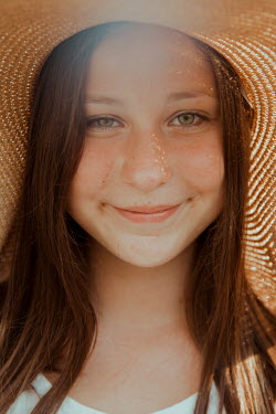 Greta Larosa SMILING YOUNG GIRL IN STRAW HAT