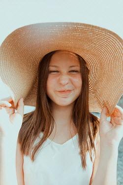 Greta Larosa PLAYFUL YOUNG GIRL IN STRAW HAT