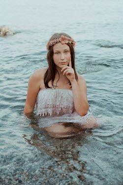Greta Larosa GIRL WITH GARLAND SITTING IN SEA