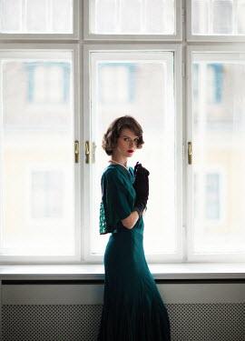 Nikaa RETRO WOMAN IN GREEN DRESS BY WINDOW