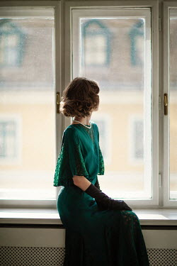 Nikaa BRUNETTE RETRO WOMAN WITH GLOVES SITTING BY WINDOW