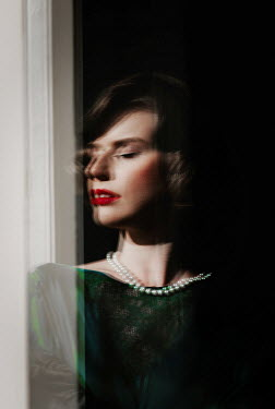 Nikaa DAYDREAMING RETRO WOMAN WITH PEARLS BY WINDOW