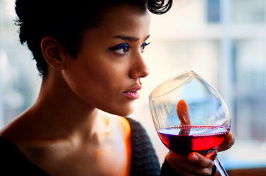 Metin Demiralay WOMAN WITH SHORT HAIR AND MAKE UP DRINKING RED WINE
