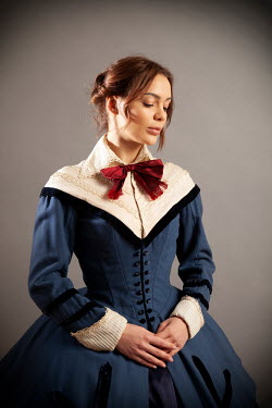 Miguel Sobreira VICTORIAN WOMAN IN BLUE DRESS WITH RED BOW