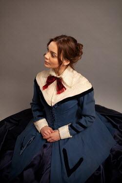Miguel Sobreira BRUNETTE VICTORIAN WOMAN SITTING IN BLUE DRESS