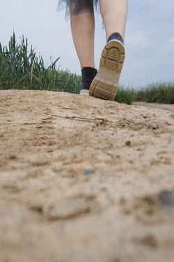 Maria Petkova FEMALE LEGS WALKING ON SANDY PATH