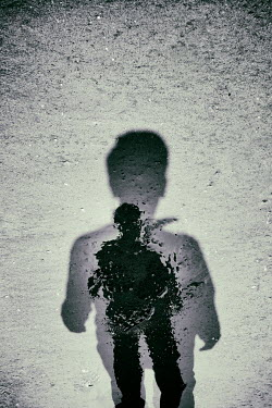Tim Robinson SHADOW AND REFLECTION OF MAN ON BEACH