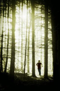 Yolande de Kort TEENAGE BOY RUNNING IN FOREST